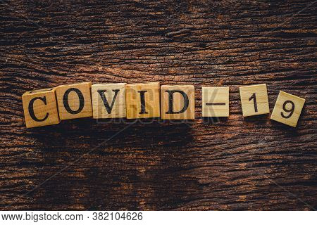 Covid-19 Name Of Corona Virus Text On Old Wood Block For Web Title Banner Background Design .