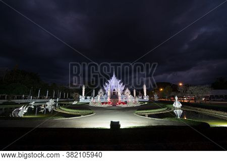 Scenery Of Wat Rong Khun Or White Temple Light Up On Light Fest Event With Dramatic Sky In Chiangrai