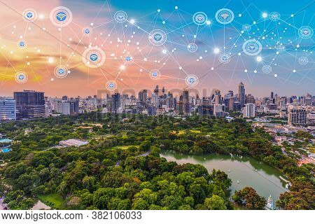 Modern City At Twilight With Network Connection Wireless Communication Concept