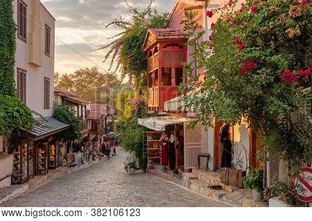 Beautiful street in the Kas old town with boutique shops at sunset, Turkey Kas Town is popular tourist destination in Turkey