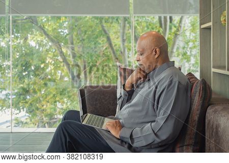 Business Elderly Black American Man, African Person Working From Home, Thinking About Problem With C