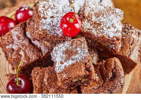 Brownie Pie With Chocolate And Cherry Filling, Garnished With Cherries.