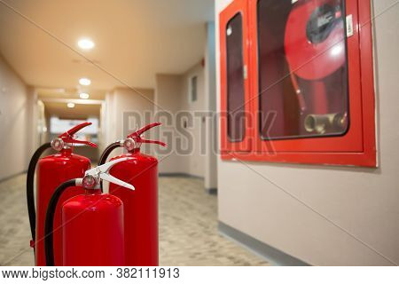 The Red Fire Extinguisher Is In The Building.