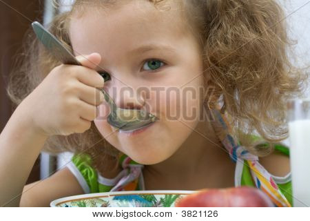 The Girl Has Breakfast Corn Flakes With Milk, Over White