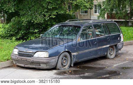 Abandoned Old Broken Car With Flat Wheels, Iskrovsky Prospekt, Saint Petersburg, Russia, August 2020