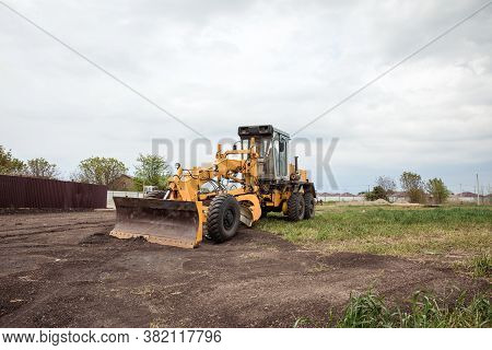 Yellow Bulldozer With Bucket. Wheel Loader. Heavy Equipment Machine. Tractor Front Loader. Construct