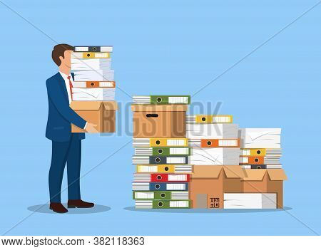 Stressed Businessman Holds Pile Of Office Folders And Documents. Overworked Business Man With Stacks