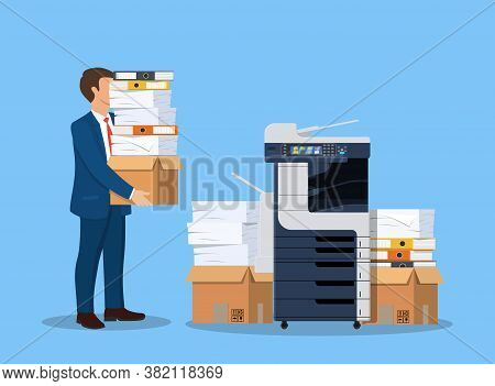 Stressed Businessman Holds Pile Of Office Documents. Overworked Business Man With Stacks Of Papers.