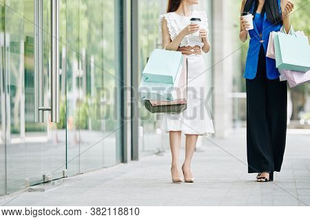 Cropped Image Of Elegant Young Women Drinking Take Away Coffee When Walking Outdoors After Shopping