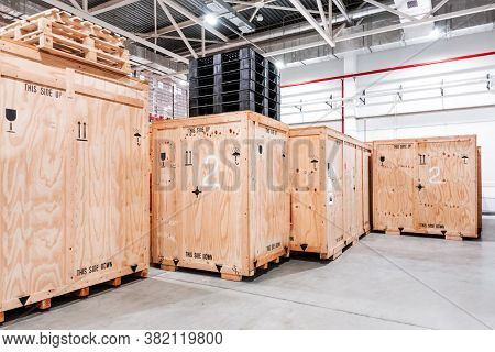 Wooden Boxes In The Warehouse. Boxes Out Of Wood For Packing Industrial Machinery. Warehousing. Pack
