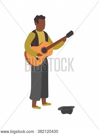 Man Plays Guitar On Street. Busker Performance, Boy Stands With Hat And Play Melody, Earn Money With