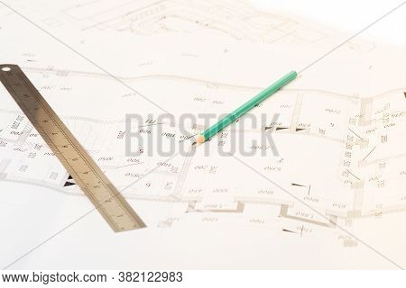 Engineering Blueprints And Design Drawings On The Table In The Architectural Office.