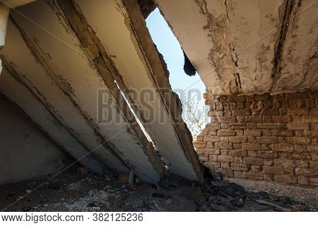 Old Destroyed Building. Broken Ceiling. Destruction And Consequences Of An Earthquake Or Natural Dis