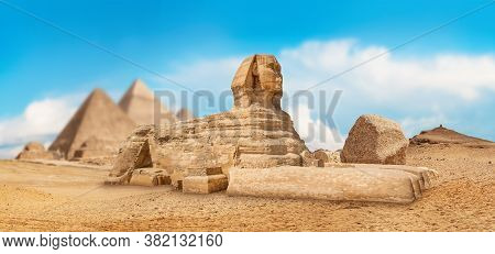 Great Sphinx And Pyramids On A Sunny Day