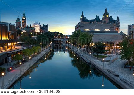 View Of Ottawa City Buildings And Rideau Canal From Mackenzie King Bridge During Sunset