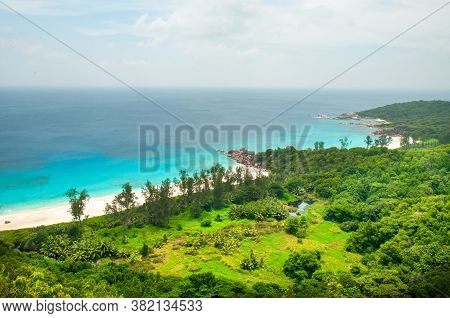 Elevated View Of The La Digue Island Coastline Withe The Bay In Front Of Petite Anse. Seychelles