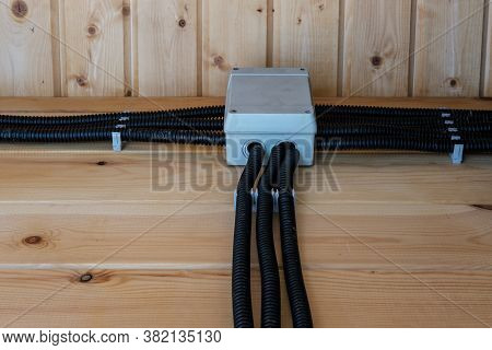 Open Electrical Wiring In The House, Hidden In An Insulating Corrugation And Goes To The Junction Bo