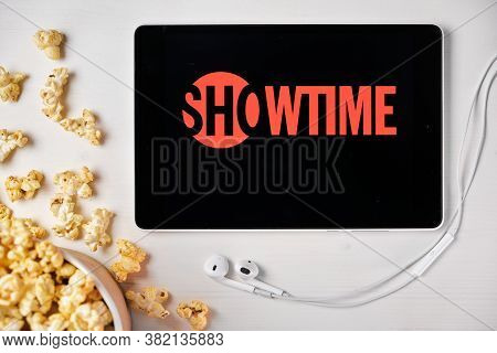 Showtime On The Screen Of The Tablet With Popcorn Box And Apple Earphones On The Background. Adverti