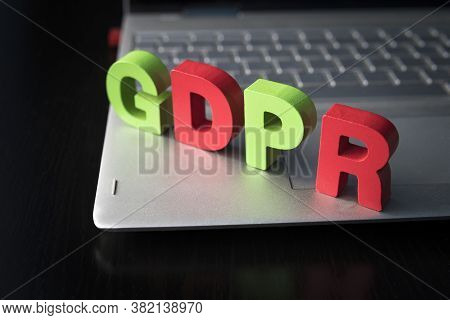 General Data Protection Regulation - Gdpr Wooden Letters Set On The Bottom Of Laptop At Black Backgr