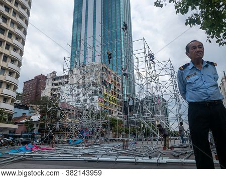 Ho Chi Minh, Vietnam - December 17,2019 : Asian Male Security Gaurd Watching Over Workers Prepareing