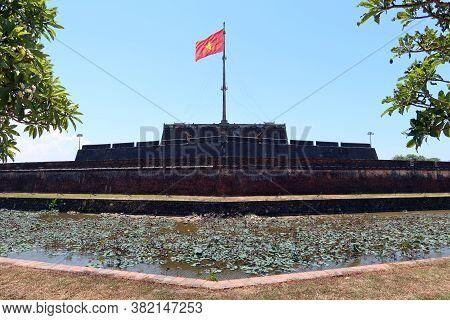 Hue, Vietnam, July 15, 2020: Large Flag Of Vietnam From The Exterior Of The Hue Citadel. Vietnam