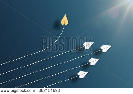 Paper Planes Flying In Formation In One Direction On Blue Background And One Paper Glider Going In D