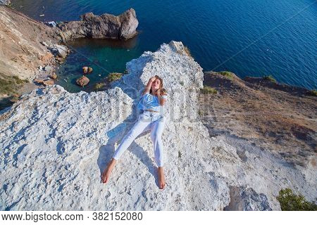 Modeling At Nature. Relax Or Stunning Landscape. Lady Laying On Hill. Fashionable Outfit. Magnificen