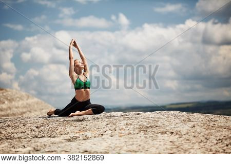 Outdoor Sports. Morning Workout. Fitness Training. Woman Doing Stretching Exercise. Picturesque Land