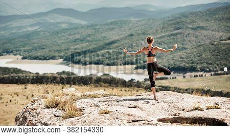 Yoga Time. Stretching And Outdoors Training. Female Wearing Sportswear. Balance Position. Breathtaki