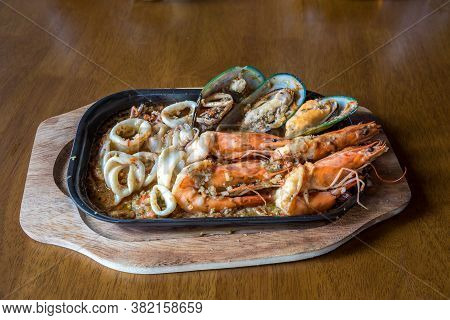 Seafood Salad With Prawns, Mussels And Squids. Fried Stir Spicy Sea Food In Hot Pan.