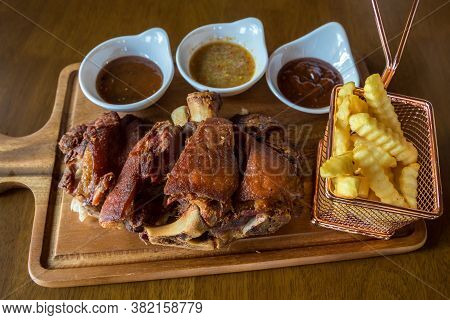 Pork Hock In German With Sauces Delicious Food. Deep Fried Pork Knuckle ,thai Style Serve With Seafo