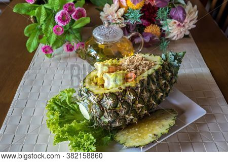 Sour Sauce Fried Rice With Pineapple. Pineapple Fried Rice. Thai Rice With Seafood In Pineapple