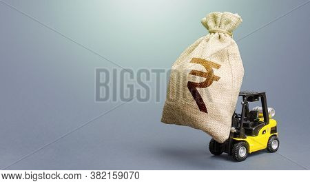 Forklift Carrying A Indian Rupee Money Bag. Strongest Financial Assistance, Business Support. Borrow
