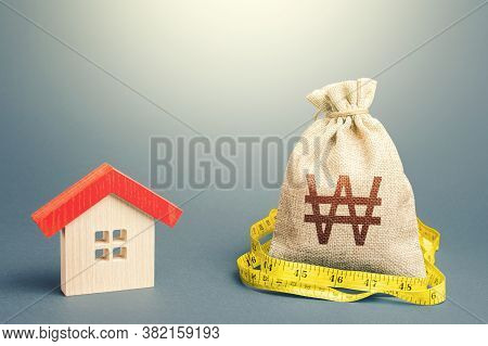 House And South Korean Won Money Bag. Mortgage Loan. Buying And Selling, Fair Price. Building Mainte