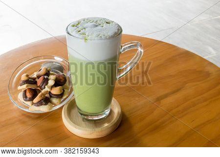 Matcha Green Tea Latte Beverage In Glass Mug With Whisk. Matcha Green Tea Latte Beverage In Glass Mu