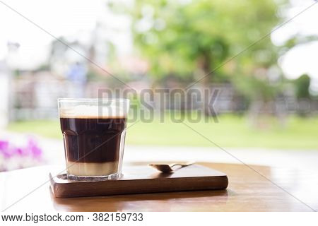 Coffee With Condensed Milk. Coffee With Condensed Milk In A Transparent Glass.vietnamese Coffee With