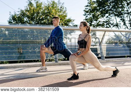 Concept Of Healthy And Active Lifestyle. Side View Of Happy Young Adult Woman And Man Making Sport T