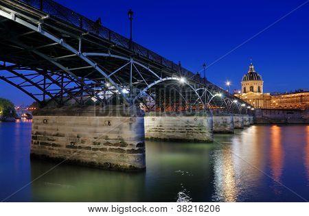 The Pont des Arts or Passerelle des Arts bridge across river Seine and Institut de France in Paris France. poster