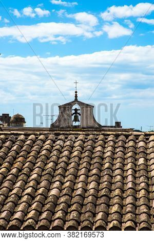 Bird's-eye view of tiled roofs. Walk along the medieval powerful defensive walls. Mediterranean coast of France. Sunny summer day. The concept of active and photo tourism