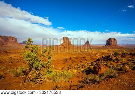 The Mittens. Huge masses of red sandstone - outliers on the Indian Navajo Reservation. The USA. Magnificent rainbow in the Monument Valley. Concept of active and photo tourism