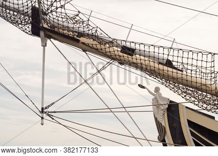 Figure On The Prow Of An Old Ship.rigging.