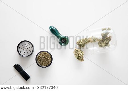 Cannabis Buds In Grinder. Marijuana Nature Bud. The Sugar Pot Leaves On Buds.