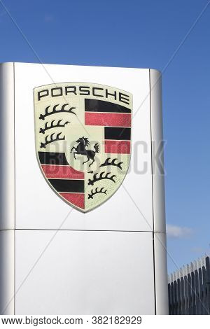 Risskov, Denmark - May 11, 2019: Porsche Logo In Front Of A Car Dealer. Porsche Is A German Automobi