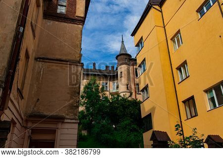 Old Architecture Tower Building Medieval City Street Of Lviv Ukraine Europe Historical Town Center L
