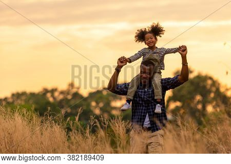 Happy African Family Father And Child Daughter Travel And Running On Meadow Nature On Silhouette Lig