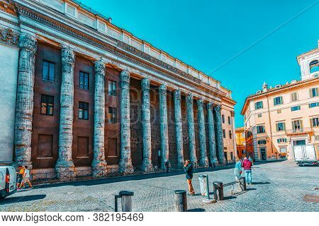 Rome, Italy - May 09, 2017 : The Temple Of The Divine Adrian( Il Tempio Di Adriano) With People On S