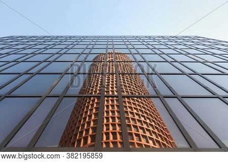 Lyon, France - March 26, 2016: Reflection Of The Part-dieu Tower In A Facade. The Building Rises 164