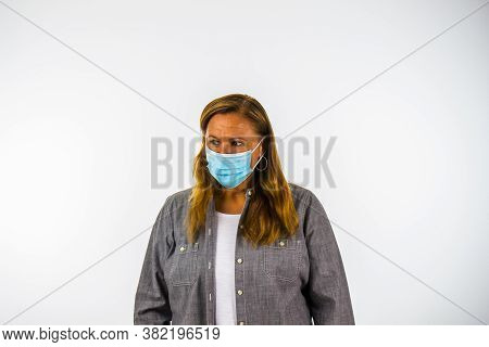 Woman Wearing Face Mask Looking Away Suspiciously