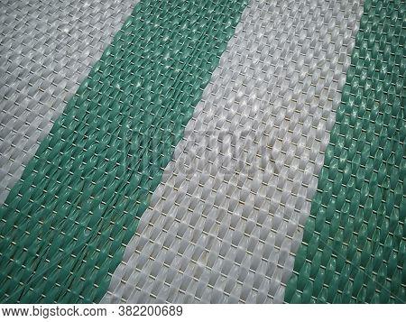 Green And White Synthetic Burlap, Close-up. Polyethylene Material. Interlacing Of Polyethylene Fiber