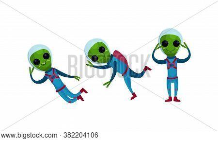 Green Alien Creatures In Spacesuit Standing And Waving Hand Vector Set
